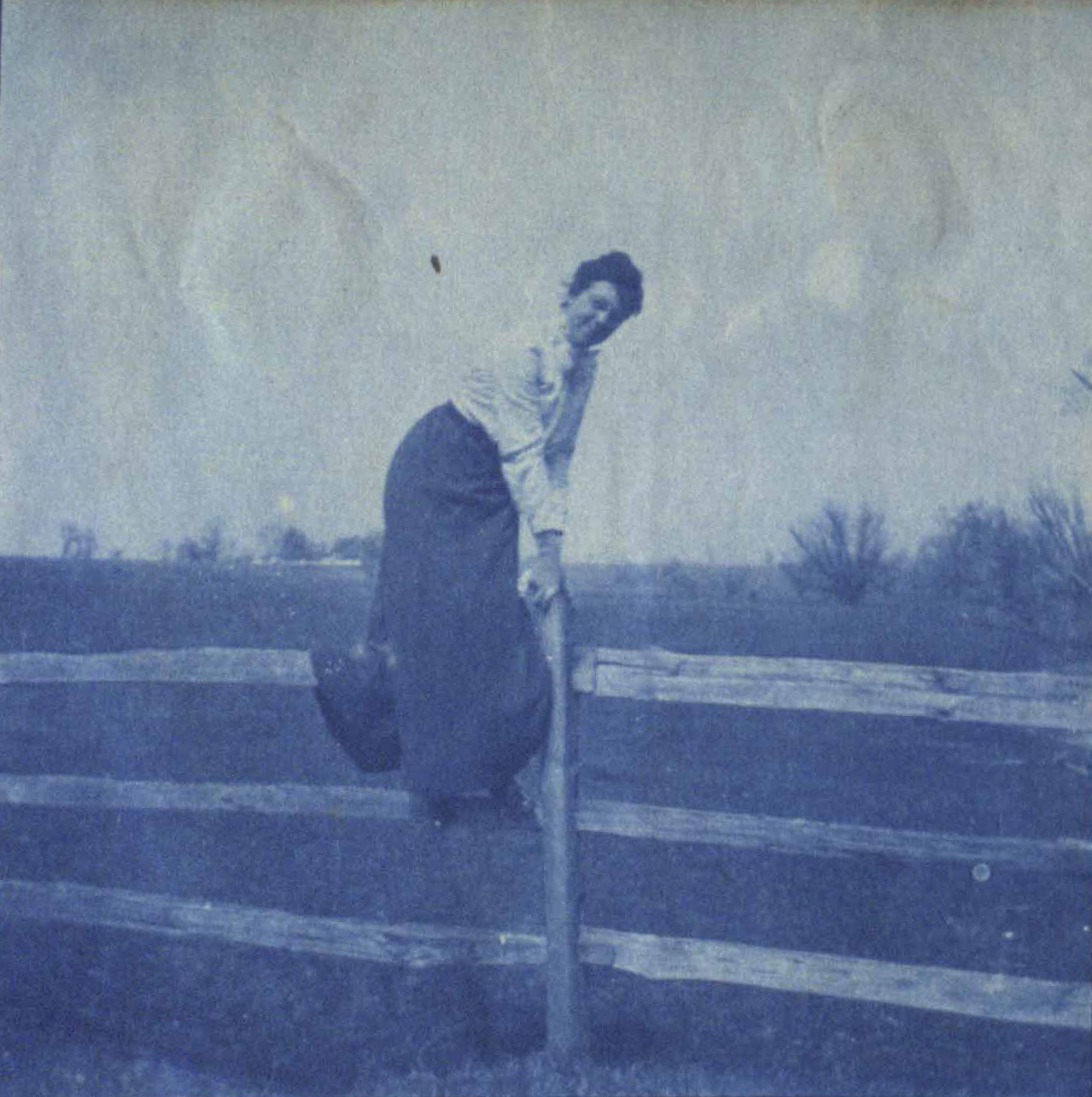 Student climbing a fence