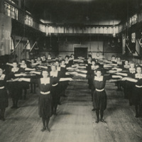 Students performing gymnastics drill as a group